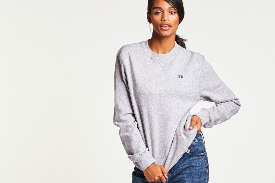 Women in a Russell Athletic sweatshirt