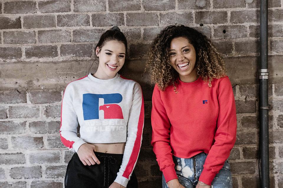 Women wearing Russell Athletic sweatshirts.