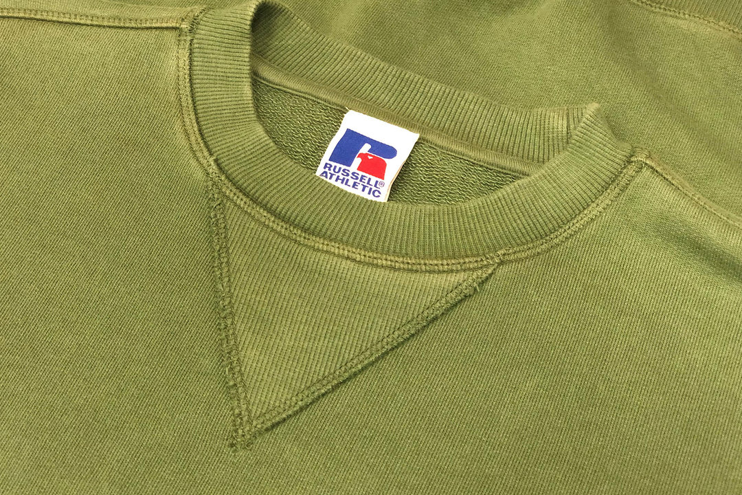 Closeup picture of Russell Athletic hoodie showing the v-notch design.